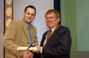 Martin Anderson Receiving Hutchison Medal from IChemE Chief Executive Trevor Evans